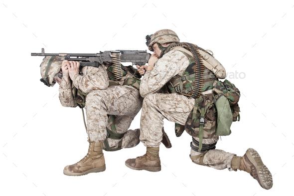 Marines shooting with machine gun studio shoot - Stock Photo - Images
