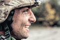 Portrait of smiling army soldier in ragged helmet - PhotoDune Item for Sale