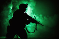 Soldiers silhouette on background of fire explosion - PhotoDune Item for Sale