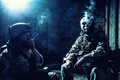 Tired commando soldiers smoking after intensive firefight - PhotoDune Item for Sale