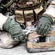 Soldier cuts wire on improvised explosive device - PhotoDune Item for Sale