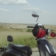 Couple Holding Hands Running Towards Retro Motorbike in the Green Desert Landscape - VideoHive Item for Sale