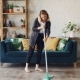 Pretty Blond Housewife Is Doing Housework Mopping Wooden Floor in Beautiful Flat Cleaning Under Sofa - VideoHive Item for Sale