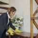 Blond Housewife Wearing Protective Rubber Gloves Is Dusting a Table at Home Doing Housework - VideoHive Item for Sale