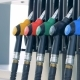 Person Takes a Nozzle for Refilling at a Filling Station - VideoHive Item for Sale