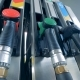 One Man Uses a Fuelling Equipment at a Gas Station, Taking a Nozzle - VideoHive Item for Sale