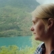 A Woman Travels By Bus in Norway, Looks Out the Window at the Beautiful Fjords - VideoHive Item for Sale