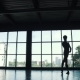 Silhouette of a Ballet Dancer Male Dancing Against the Background of a Large Window - VideoHive Item for Sale