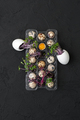 A pallet with fresh quail eggs and a watercress on a black table - PhotoDune Item for Sale