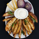 Baked potatoes and red lus with rosemary, lemon and aioli sauce - PhotoDune Item for Sale