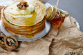 Stack of pancakes on a paper napkin, served with honey and walnu - PhotoDune Item for Sale