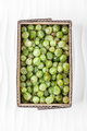 Gooseberries in a cardboard box on a white textured background. - PhotoDune Item for Sale