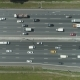 Cars on Highway in City in Sunny Summer Day. Aerial Vertical Top-Down View - VideoHive Item for Sale