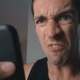 Angry Man Aggressively Uses Smartphone at Home in the Kitchen - VideoHive Item for Sale
