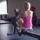 Young Athletic Woman Doing Rowing Machine Workout at the Gym - VideoHive Item for Sale