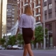 Female with Blond Hair Walks on the Street - VideoHive Item for Sale