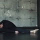 Male Ballet Dancer Sitting on Twine on the Floor and Doing Stretching - VideoHive Item for Sale