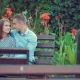 Young Couple Spend Time Together on a Bench in a Holiday Park - VideoHive Item for Sale