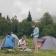 Friends Resting in Summer Camping. People Resting Near Camping Tent in Forest - VideoHive Item for Sale