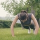 Fitness Girl Doing Push Ups Exercises During Outdoor Training in Summer Park - VideoHive Item for Sale