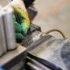 Worker Solders Metal Part for Future Batteries