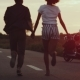The Couple Is Smoothly All Inlove Holding Hands Running in the Sunset Towards Their Motorbike - VideoHive Item for Sale