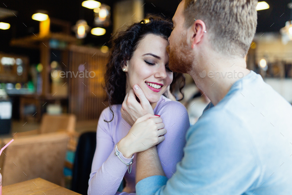 Young couple on date in coffee shop - Stock Photo - Images