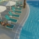 Aerial: Beautiful Girl Lies on a Lounger By the Pool - VideoHive Item for Sale