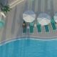 Aerial: Beautiful Girl Lies on a Chaise-longue By the Pool, Drinking a Cocktail - VideoHive Item for Sale