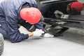 Mechanic replacing lug nuts changing tires on vehicle-10 - PhotoDune Item for Sale