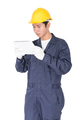 Worker using a tablet and holding blueprint on white-3 - PhotoDune Item for Sale