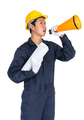 Young worker shouting for announce through a megaphone - PhotoDune Item for Sale