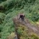 Aerial View of Couple of Hikers Standing on the Edge of a Cliff in Iceland - VideoHive Item for Sale