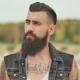 Portrait of a Brutal and Bearded Man with Tattoos on His Shoulders - VideoHive Item for Sale