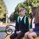 Young Boy and Girl Are Sitting on the Bench - VideoHive Item for Sale