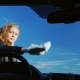 Young Attractive Woman Wiping the Windshield of a Car. View From Inside the Car - VideoHive Item for Sale