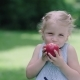 Child Eating Juicy Apple Outdoors - VideoHive Item for Sale