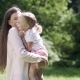 Happy Family. Woman And Kid Hugging And Kissing In Nature - VideoHive Item for Sale