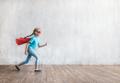 Running little super girl in studio - PhotoDune Item for Sale