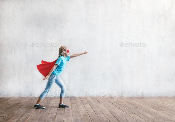 Flying super hero in studio - Stock Photo - Images