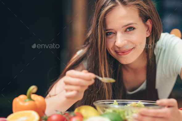 Young woman in the kitchen - Stock Photo - Images