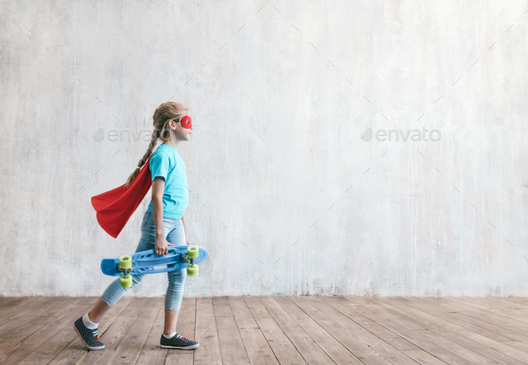 Little girl with a skateboard in studio - Stock Photo - Images
