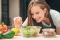 Smiling young woman in the kitchen - PhotoDune Item for Sale