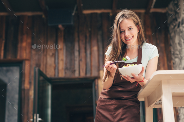 Smiling girl in an apron - Stock Photo - Images
