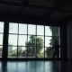Silhouette of a Ballet Dancer Male Against the Background of a Large Window. the Dancer Makes a High - VideoHive Item for Sale