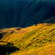 Colorful sunset with mountain meadows and hut in Caucasus, Kazbegi, Country of Georgia - PhotoDune Item for Sale