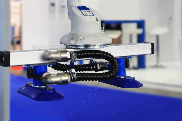 Vacuum suction of an industrial robot - Stock Photo - Images