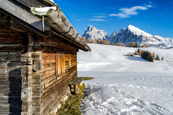 Wooden cabin in the snow with a view on the Dolomites - Stock Photo - Images