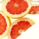 Grapefruit Slices Fall Into the Water - VideoHive Item for Sale
