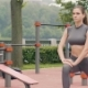 Beautiful Woman Doing Stretching Exercises at Fitness Training in City Park - VideoHive Item for Sale